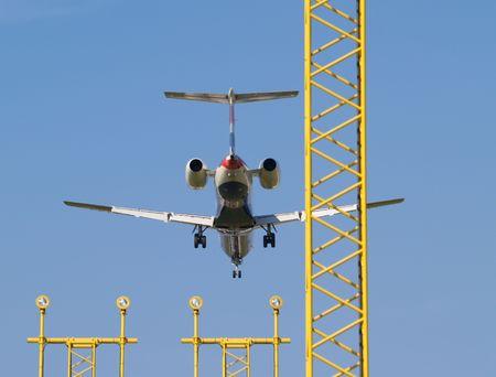 Airplane landing over landing lights. photo