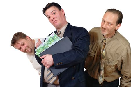 Three slick punk-like doubtful sales or business men grinning with laptop and euro bills. Concept of doubtful financial transactions on the Internet. slick trade practices, online hoaxes, criminal gain, spamming, phishing and fraud. Stock Photo