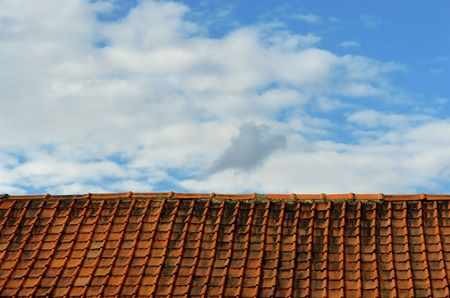surrealistic: Simplistic binary concept of a rooftop with old pantiles and sky, with a high degree of repetition, perfectly horizontal for banners in a surrealistic mood. Stock Photo