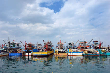 Industrial colorful exotic fishing boats with nets and gear, docked in a Southeast Asian tropical port. Oroquieta City, Mindanao, Philippines.