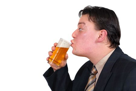Alternative punk businessman drinking cold beer. Isolated over white with copyspace. photo