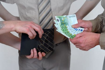 witness: Business and sales concept of a cash payment transaction with a bystander witness. Detail of hand passing the euro bills and the receivers wallet. Stock Photo