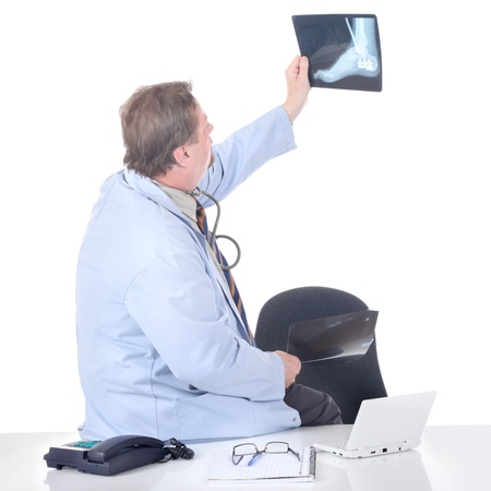 peering: Doctor peering at an x-ray Stock Photo
