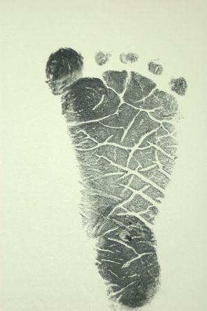 inkpad: Newborn Footprint on Beige Stock Photo