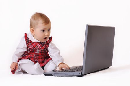 curios: Baby and laptop Stock Photo