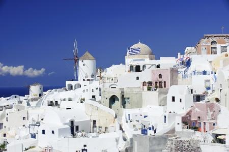 aegean sea: Winmills in Oia town on Santorini island, Greece