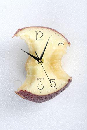 eatten apple of time Stock Photo