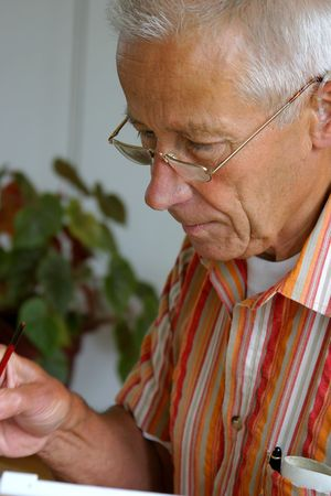 occupied: Retired man working on his hobby