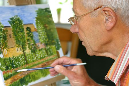 Retired man painting