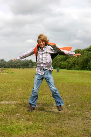 Attractive blond young teenager jumping photo