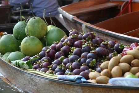 Boat filled with fruit at Damnoen Saduak floating market Stock Photo