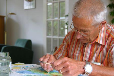 man painting: Older man painting