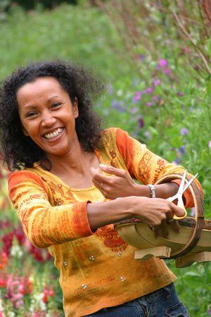 Happy woman working in the garden photo