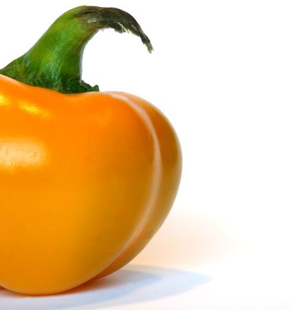 Yellow bell pepper on white background photo