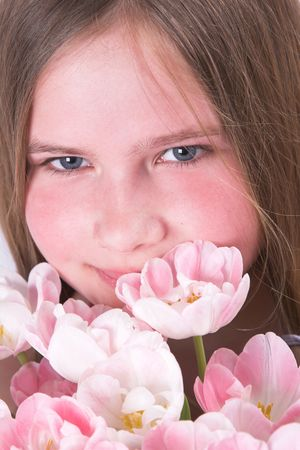heartwarming: Beautiful young girl with pink tulips for mother on mothers day