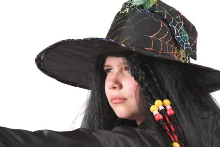 Cute little witch looking very serious photo