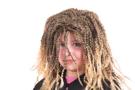 costum: Little girl wearing a blond rasta wig Stock Photo