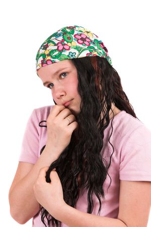 timid: Shy ten year old girl in timid pose wearing a bandana Stock Photo