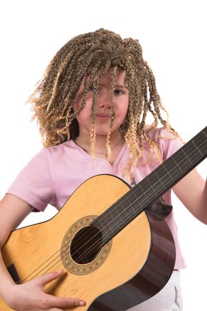 Pretty ten year old girl with rasta curls playing her guitar photo