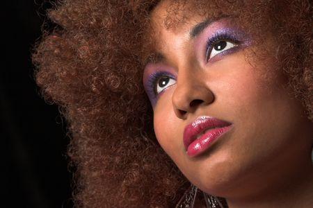 Beautiful black woman on black background Stock Photo