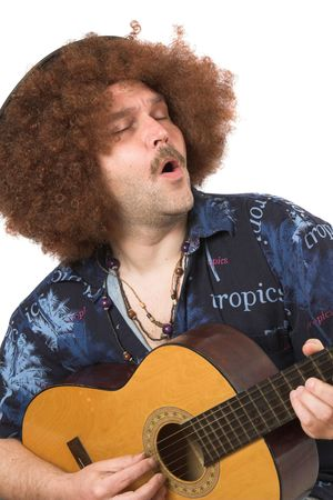 Hippie singing along with his guitar photo