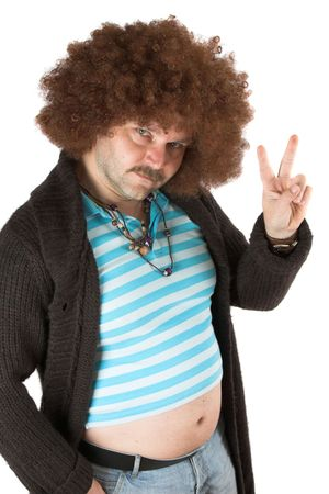 Old hippie with beerbelly holding up his fingers in peace sign photo
