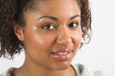 Beautiful woman with her face covered in sweat after working out Stock Photo