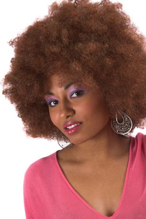 afro hairdo: beautiful woman in pink top and extreme makeup
