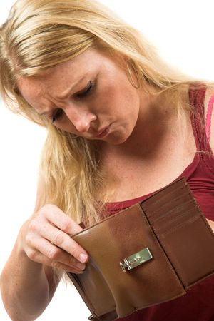 Pretty blond woman looking into her wallet with a worried face photo