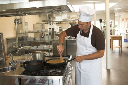 Italian checking stirring in his pasta sauce