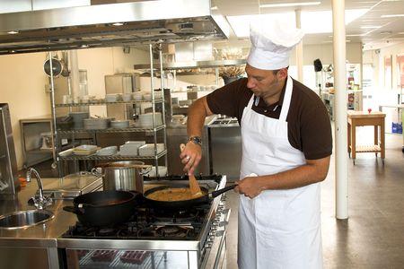 stirring: Italian checking stirring in his pasta sauce