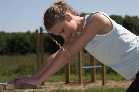 pretty blond woman doing stretching exercises outdoor Stock Photo - 458485