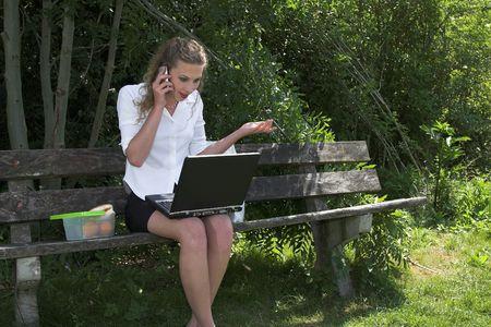 disbelief: pretty businesswoman in the park; disbelief Stock Photo