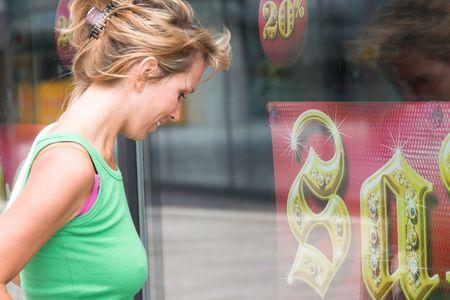 departmentstore: Pretty blond girl window shopping