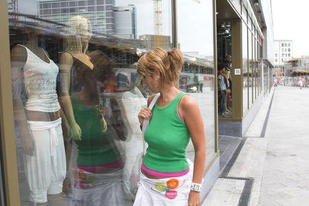 departmentstore: Prett blond girl window shopping Stock Photo