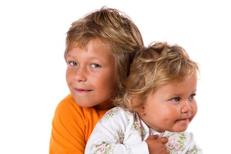 Two young kids posing together on white background Stock Photo