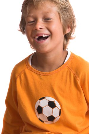 front teeth: Pretty blond boy laughing happily. Two of his front teeth are missing Stock Photo