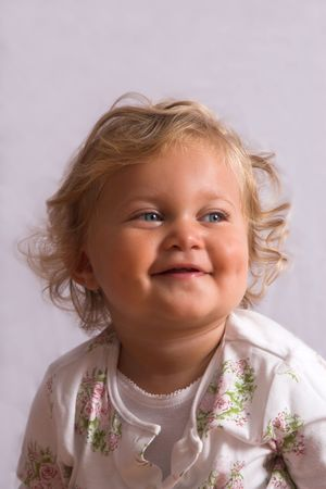 two year old: Cute little two year old on grey background smiling