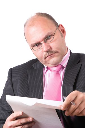 Businessman looking very shocked at his notepad Stock Photo - 496795