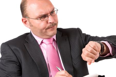 time critical: Businessman looking at his watch worried about the time