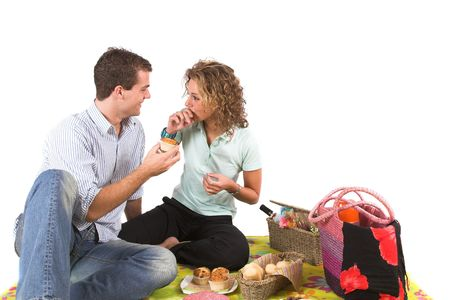 picnic blanket: Lovely young couple having a picnic Stock Photo