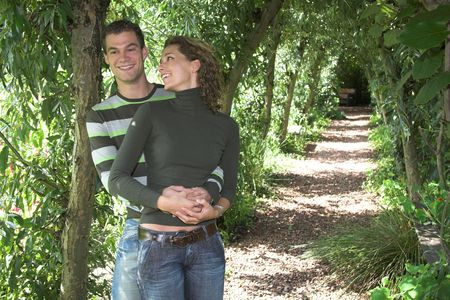 eachother: Lovely young couple enjoying eachother outdoors in the park Stock Photo