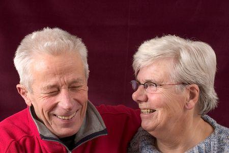 Laughing senior couple photo