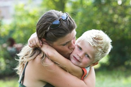 Mother kissing her son Stock Photo - 554012