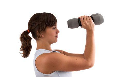 deltoids: pretty brunette doing some shoulder exercises with dumbbels Stock Photo