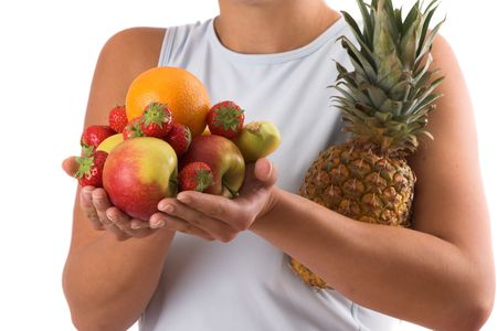 Woman with her hands full of healthy fruit photo