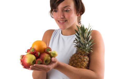 Girl holding a pile of various fruits in her hands photo