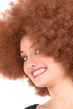 Pretty teen with afro wig pulling faces photo