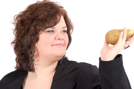 Big woman holding up a pear