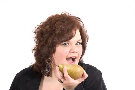 Big woman about to take a bite out of a pear